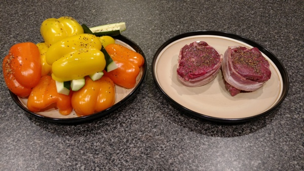 Seasoned veggies and steak about to go on kamado joe